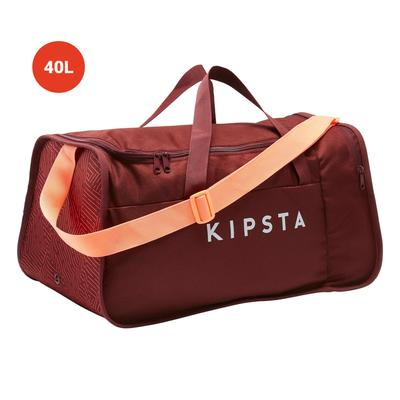 5959353f7e ... bleu et orange Sac de sport Kipocket 40 litres rouge et corail ...